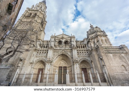 Side view of Toledo Cathedral, wide angle, cloudy day, Spain