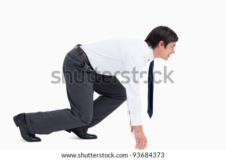 Side view of tradesman in sprinting position against a white background