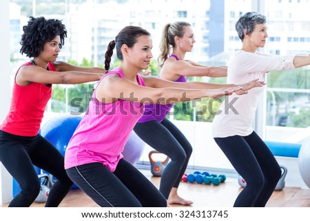 Side view of women exercising in fitness studio - stock photo