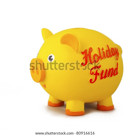 Side view of yellow piggy bank, isolated on white. - stock photo