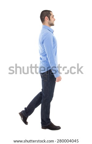 side view of young arabic business man in blue shirt walking isolated on white background - stock photo