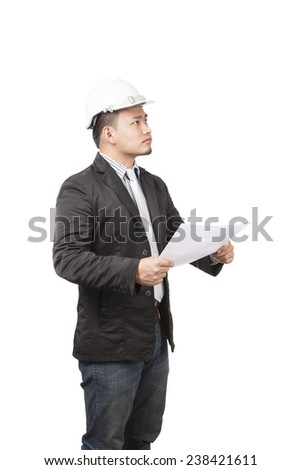 side view of young asian wearing safety helmet working engineering man holding project paper work isolated white background use for engineer working in construction site - stock photo