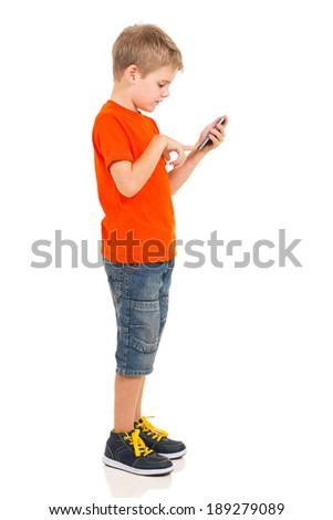 side view of young boy using cell phone - stock photo