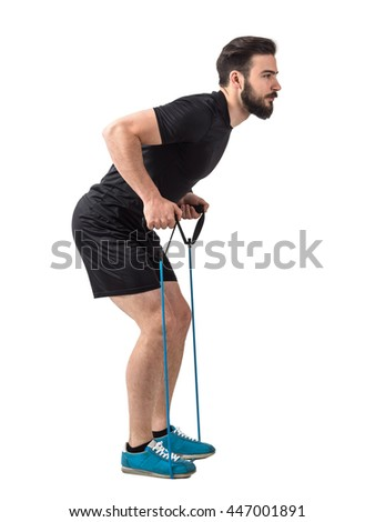 Side view of young fit athlete with resistance bands doing back exercise. Full body length portrait isolated over white studio background. - stock photo