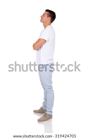 side view of young man looking up over white background - stock photo