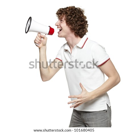 Side view of young man yelling into the megaphone, over white background - stock photo