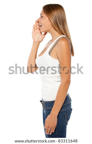 Side view of young woman calling out to someone over white background - stock photo