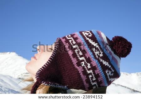 side view of young woman enjoying mountain - stock photo