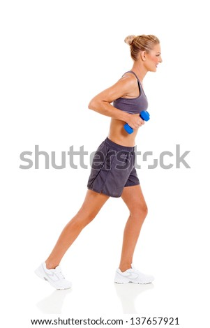 side view of young woman exercising with dumbbells on white background