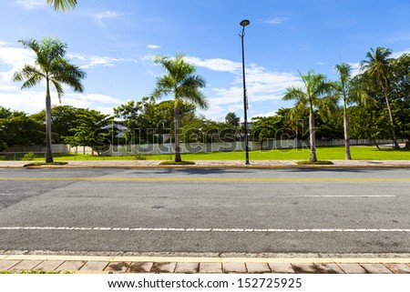 Side View On Asphalt Street - stock photo