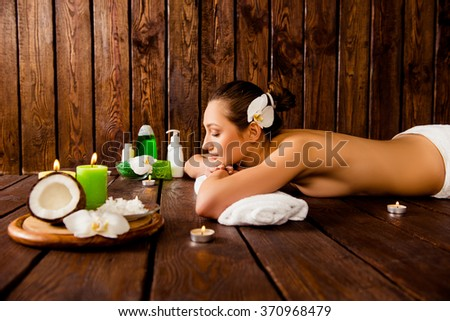 Side view photo of attrative young girl  relaxing in spa salon - stock photo