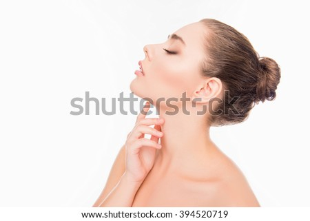Side view photo of  woman with closed eyes touching her neck - stock photo