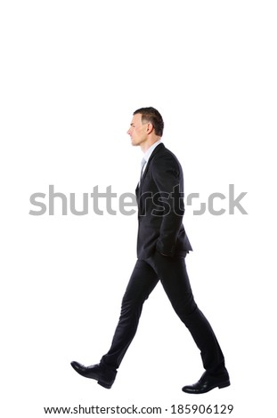 Side view portrait of a businessman walking isolated on a white background - stock photo