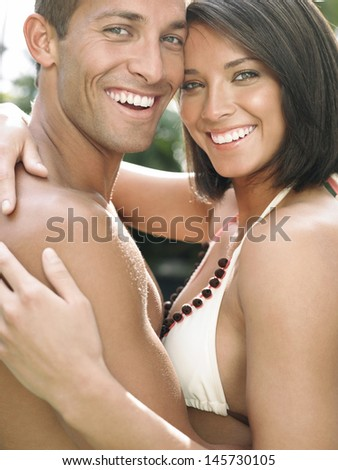 Side view portrait of a happy young couple - stock photo
