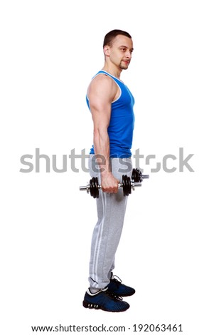 Side view portrait of a man standing with dumbbells over white background - stock photo