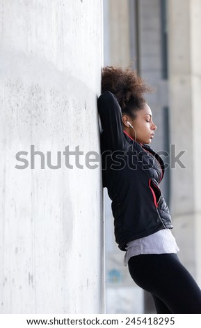 Side view portrait of a young woman relaxing after workout
