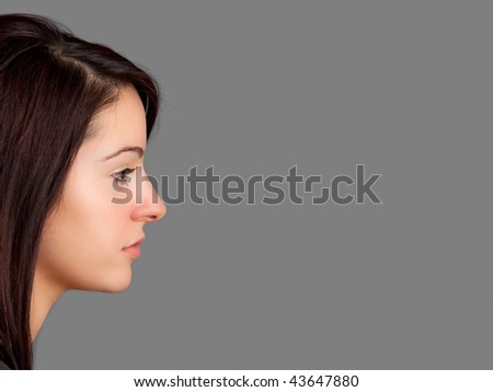 Side-view portrait of an attractive young woman. Room for text or copyspace. - stock photo