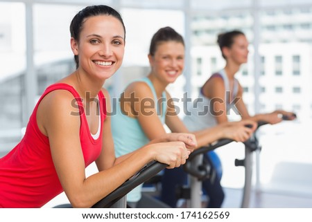 Side view portrait of fit young people working out at class in gym - stock photo