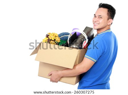 side view portrait of handsome young man carrying box full of stuff on white background - stock photo