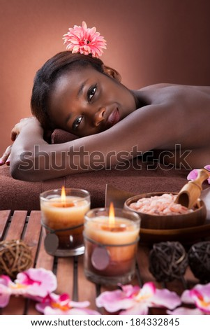 Side view portrait of smiling young woman relaxing at beauty spa - stock photo