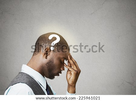 Side view portrait young puzzled business man thinking solving problem fingers on forehead looking down question mark over head isolated grey wall background copy space. Emotion expression perception - stock photo