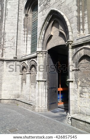 Side view to a door to St Nicholas church, Ghent, Belgium