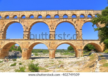 Side view to ancient arches of Pont du Gard near Nimes, France