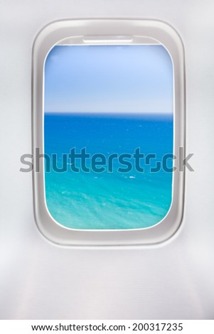 side window of airplane with sea view - stock photo
