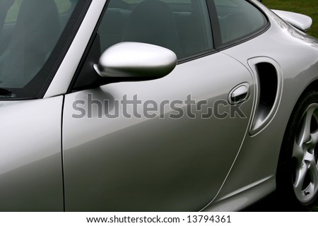 side wing mirror and air intake of silver sportscar