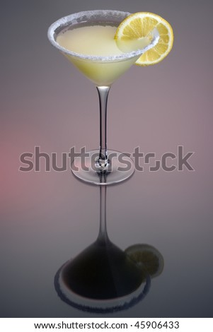 Sidecar cocktail with orange garnish on grey background - stock photo