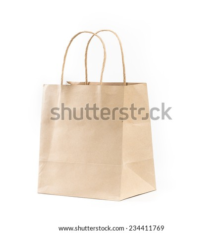 sideview brown paper shopping bag on isolated white background - stock photo