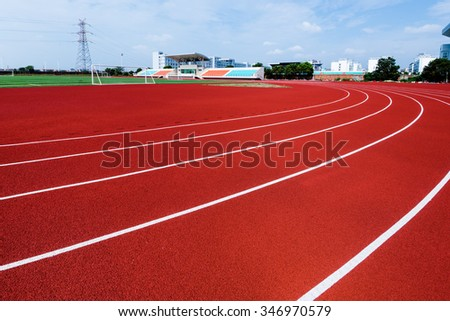 sideview of a red running track - stock photo