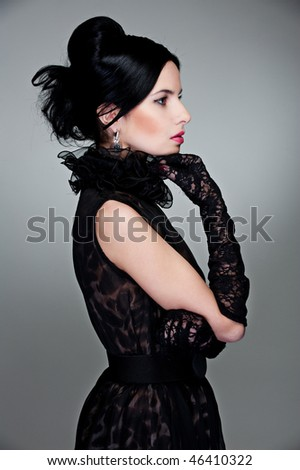sideview of beautiful woman in evening dress and gloves - stock photo