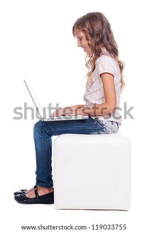 sideview of smiley girl with laptop. full length photo over white background - stock photo