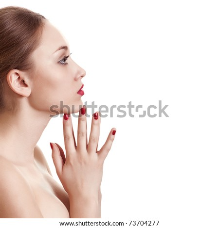 sideview portrait of beauty woman with red bright manicure on white background - stock photo
