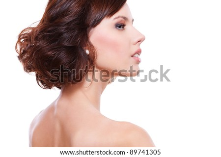 sideview portrait of young alluring woman. isolated on white background