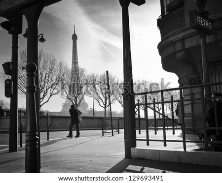 Sidewalk and metro entrance in Paris, France. Eiffel Tower in the background - stock photo