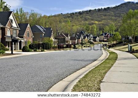 Sidewalk and street in a beautiful modern nieghborhood. - stock photo