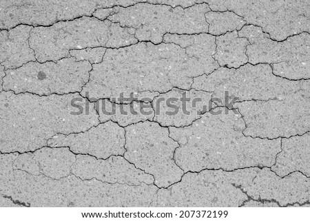 Sidewalk asphalt road with cracks - stock photo