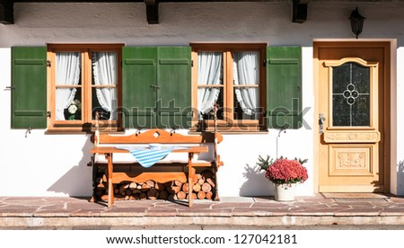 sidewalk at a typical old bavarian farmhouse - stock photo