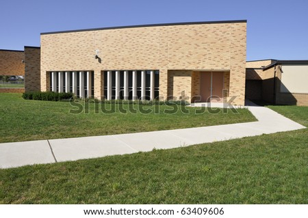 Sidewalk by a modern school building in Whitehall, Pennsylvania. - stock photo