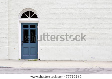sidewalk by brick wall & door - stock photo