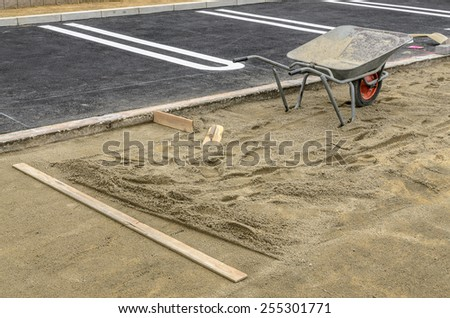 Sidewalk construction base preparations with tools. - stock photo