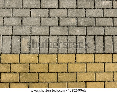 Sidewalk from brick tiles. Yellow, grey color. Horizontal view