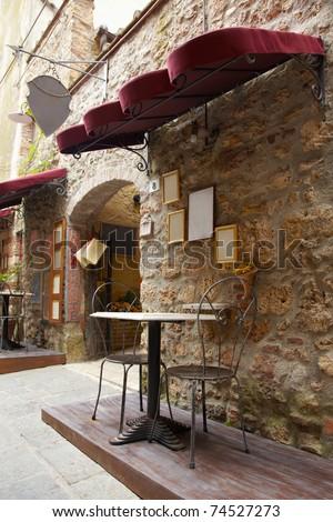 Sidewalk restaurant in Italy, Tuscany - stock photo