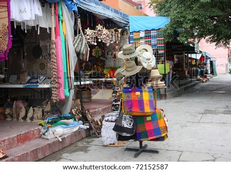 Sidewalk shopping in Mexico for vacation souvenirs. - stock photo