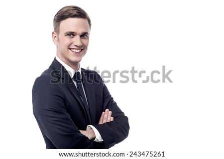 Sideways of businessman standing with folded arms - stock photo