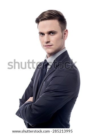 Sideways of confident businessman over white - stock photo