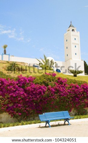 Sidi Bou Said Tunisia Africa  El Ghofrane  Tunisian mosque on Place du 7 Novembre   with flower garden - stock photo