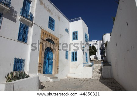 Sidi Bou Said - typical building with white walls, blue doors and windows - stock photo